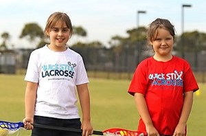 Lara, 9, and Deanna, 8, are giving the Quick Stix Challenge a go.