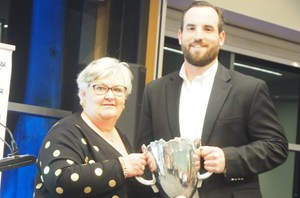 Sean Aaron receiving the State League Best & Fairest
